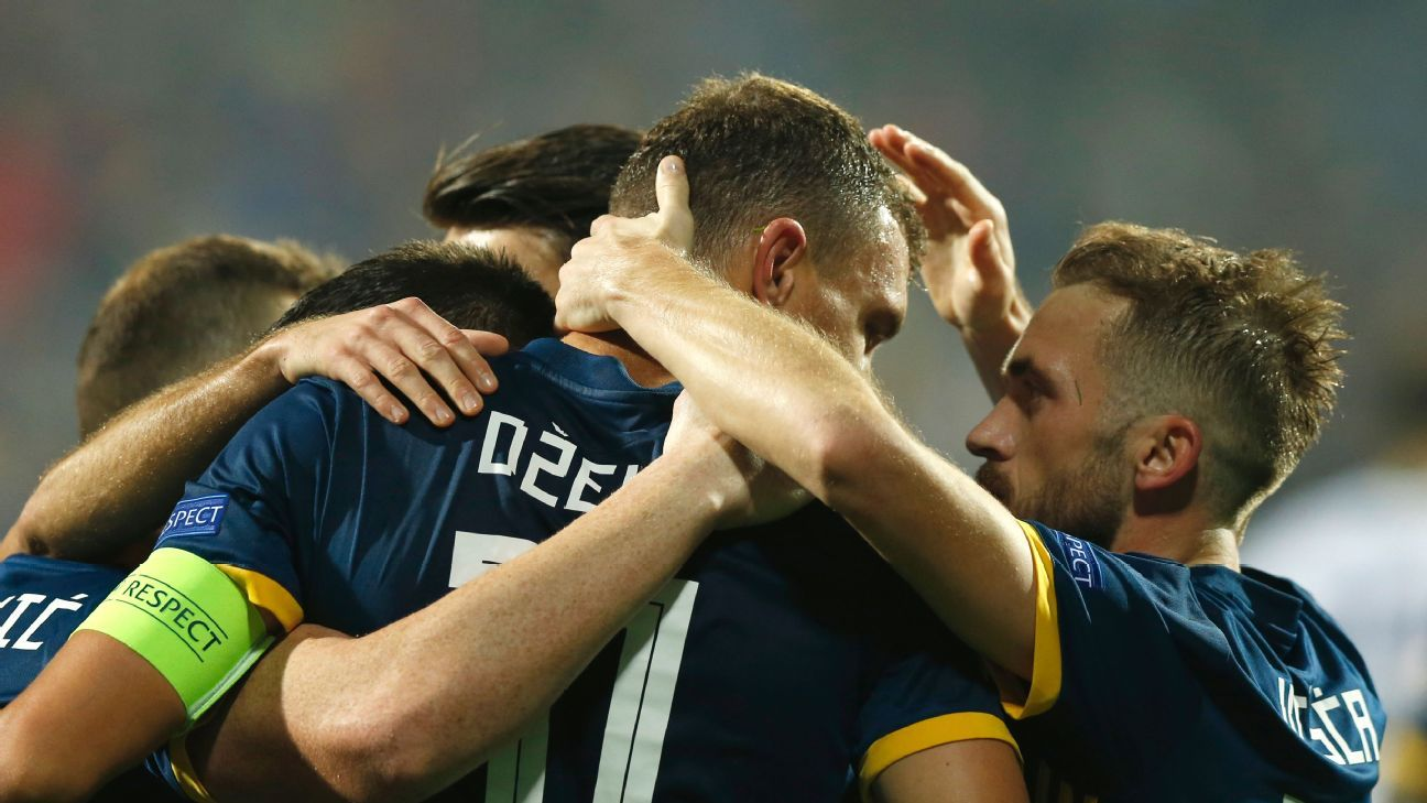 Bosnia's Edin Dzeko celebrates with teammates after scoring against Northern Ireland.