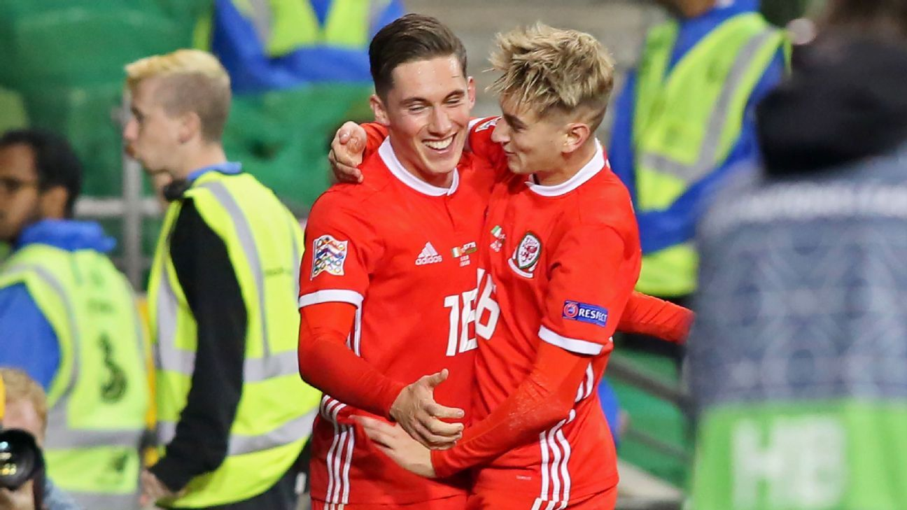 Wales' midfielder Harry Wilson, left, celebrates with teammate David Brooks after scoring a goal against the Republic of Ireland.