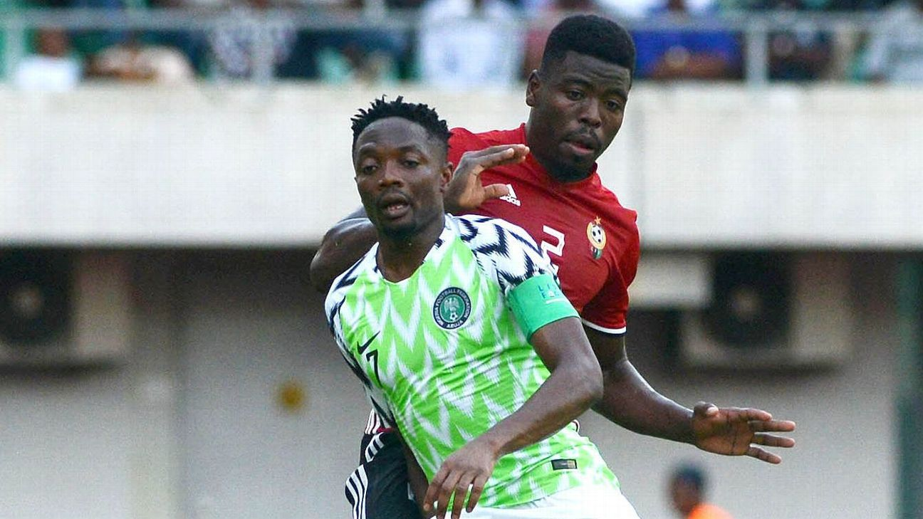 Ahmed Musa of Nigeria challenged by Ahmed Al Magashi of Libya