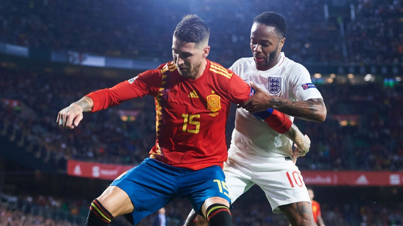 Spain's Sergio Ramos, left, battles for possession with England's Raheem Sterling.