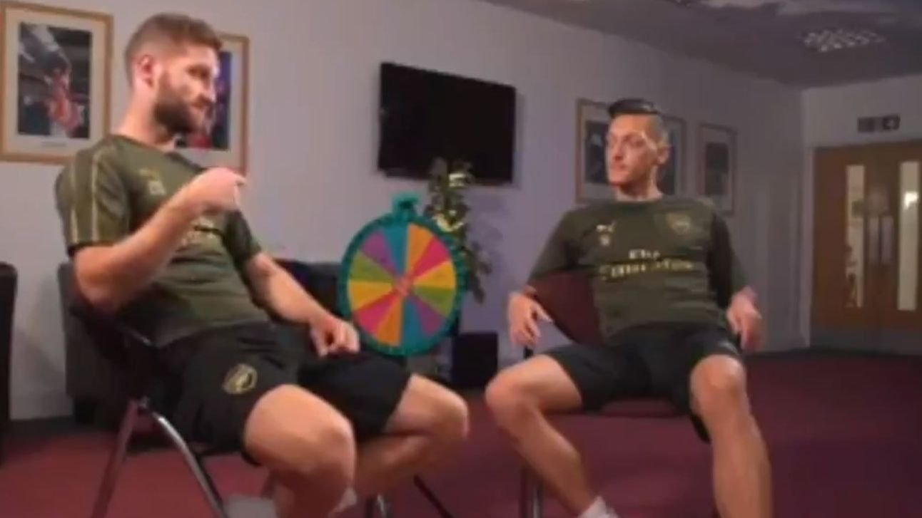 Arsenal teammates Shkodran Mustafi and Mesut Ozil answers questions determined by the wheel