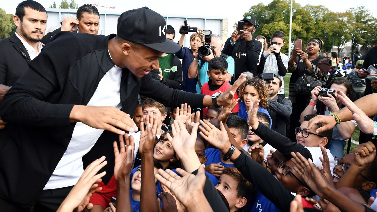 Kylian Mbappe greets fans in Bondy, his home town.
