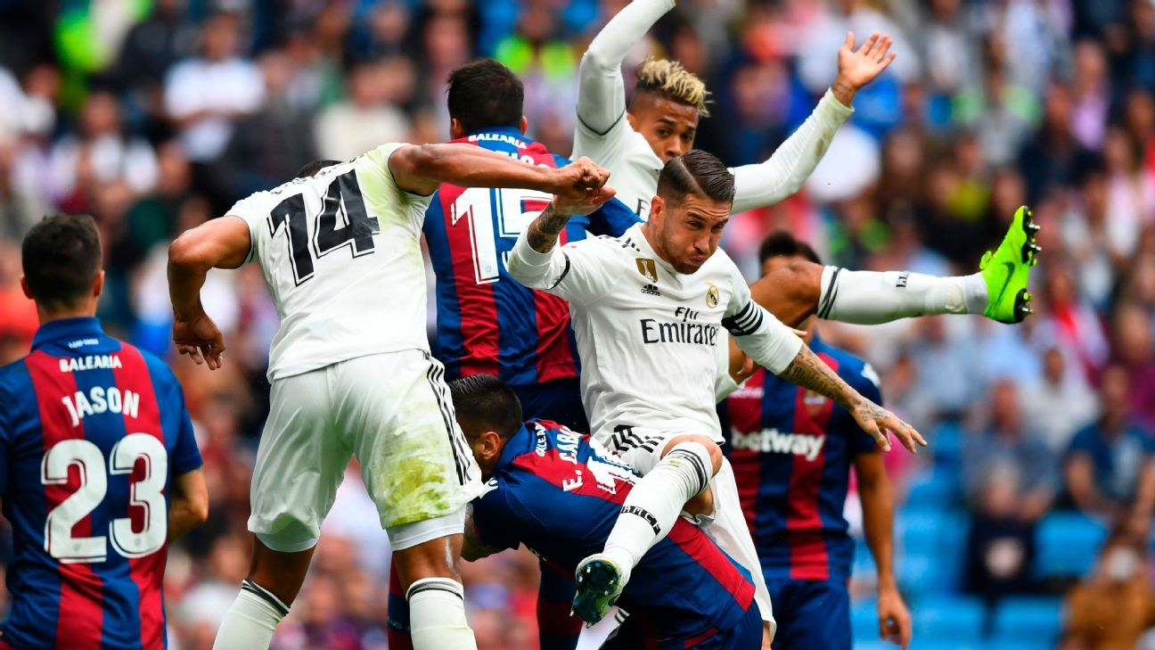 Real Madrid's Sergio Ramos gets tangled up with several players during the match against Levante