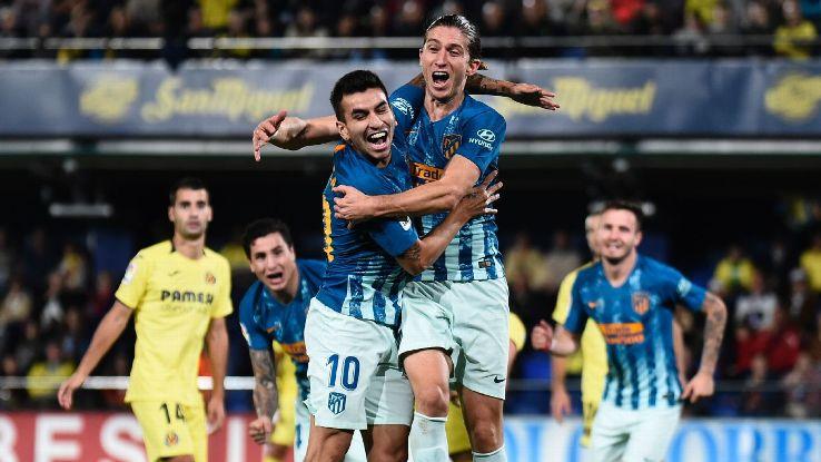 Filipe Luis (R) celebrates with Angel Martinez Correa.