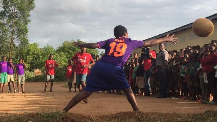 Orphans in Malawi play football in their new Sadio Mane shirts.