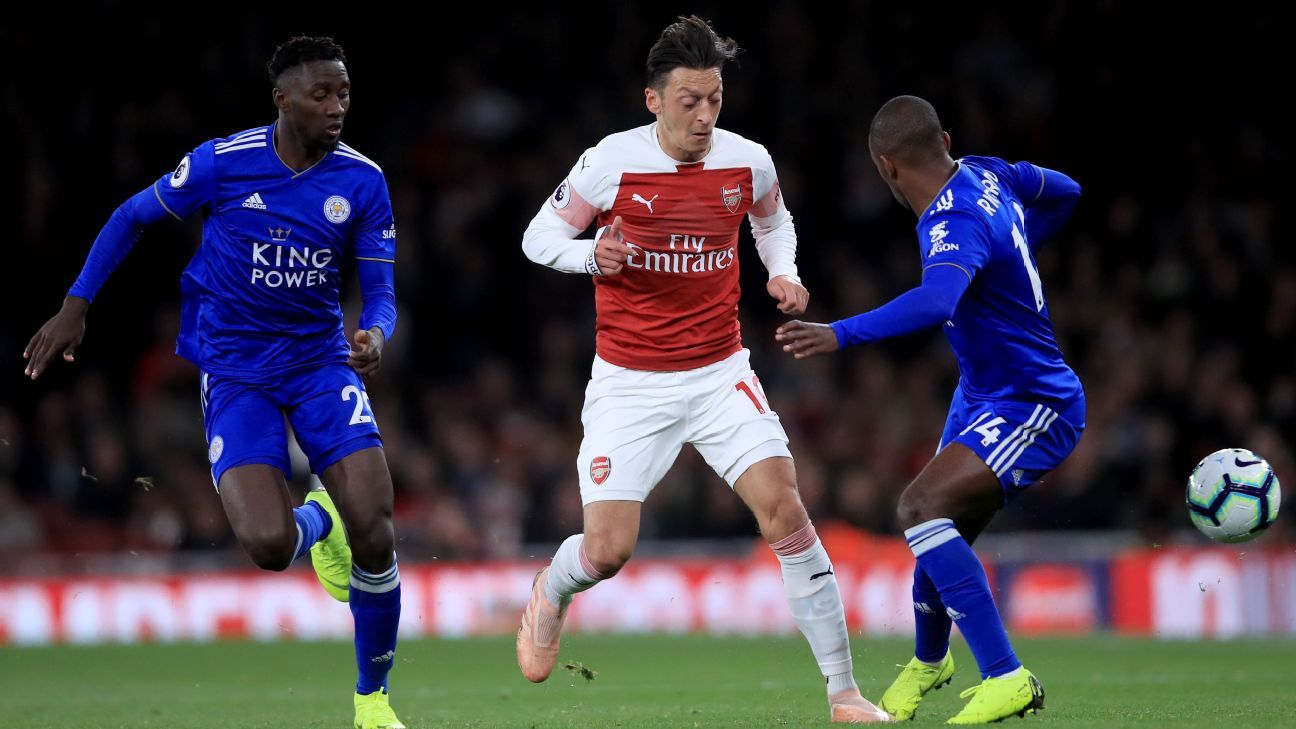 Mesut Ozil vies for the ball during Arsenal's Premier League match against Leicester City.