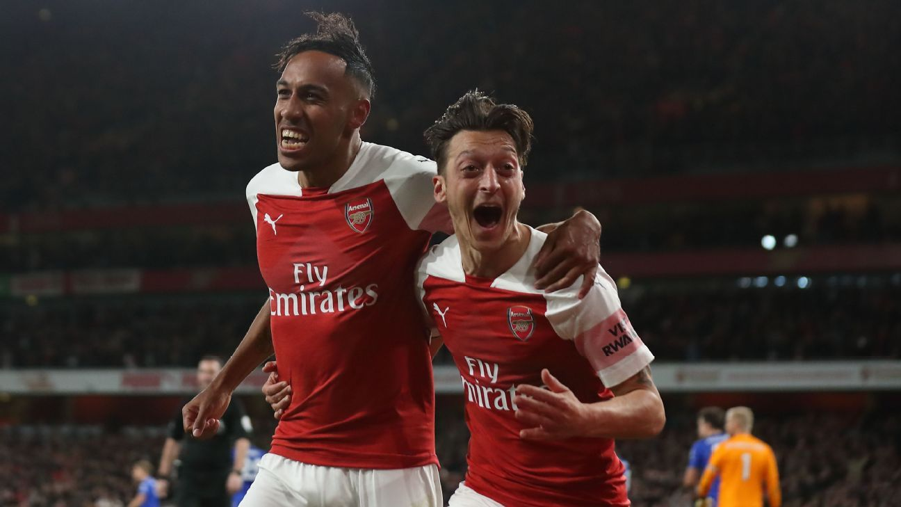 Pierre-Emerick Aubameyang and Mesut Ozil celebrate during Arsenal's Premier League match against Leicester City.