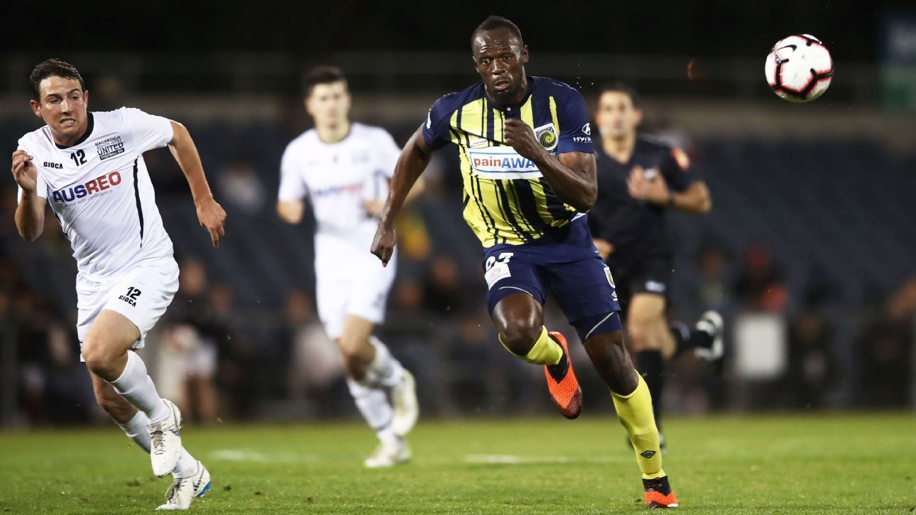 Usain Bolt runs down the ball in a friendly between Central Coast Mariners and Macarthur South West United.