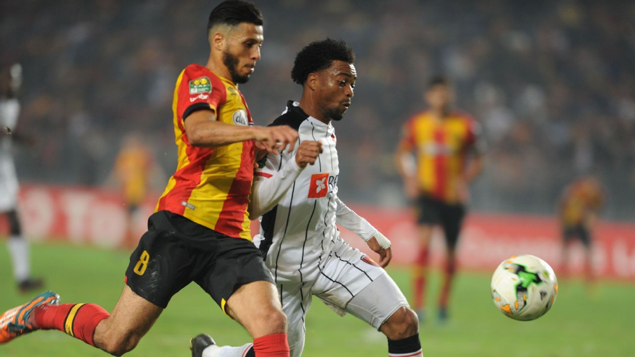 Anice Badri of Esperance is challenged by Salomao Troco of Primeiro de Agosto