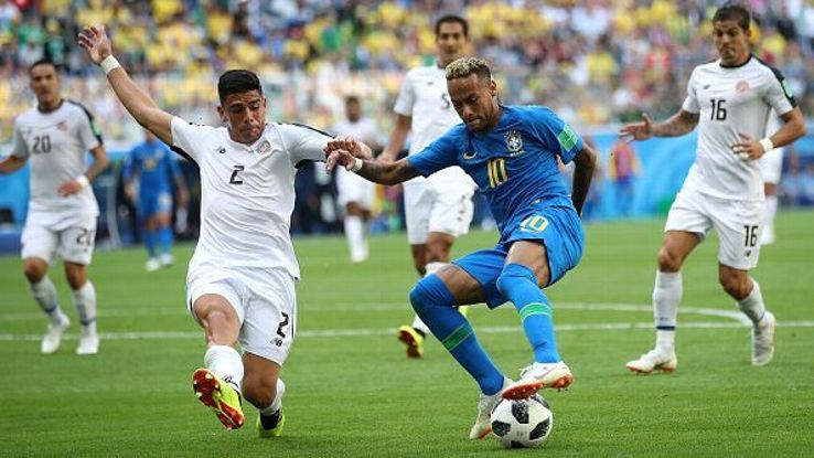 Johnny Acosta tries to stop Neymar during the 2018 FIFA World Cup Russia group E match between Brazil and Costa Rica