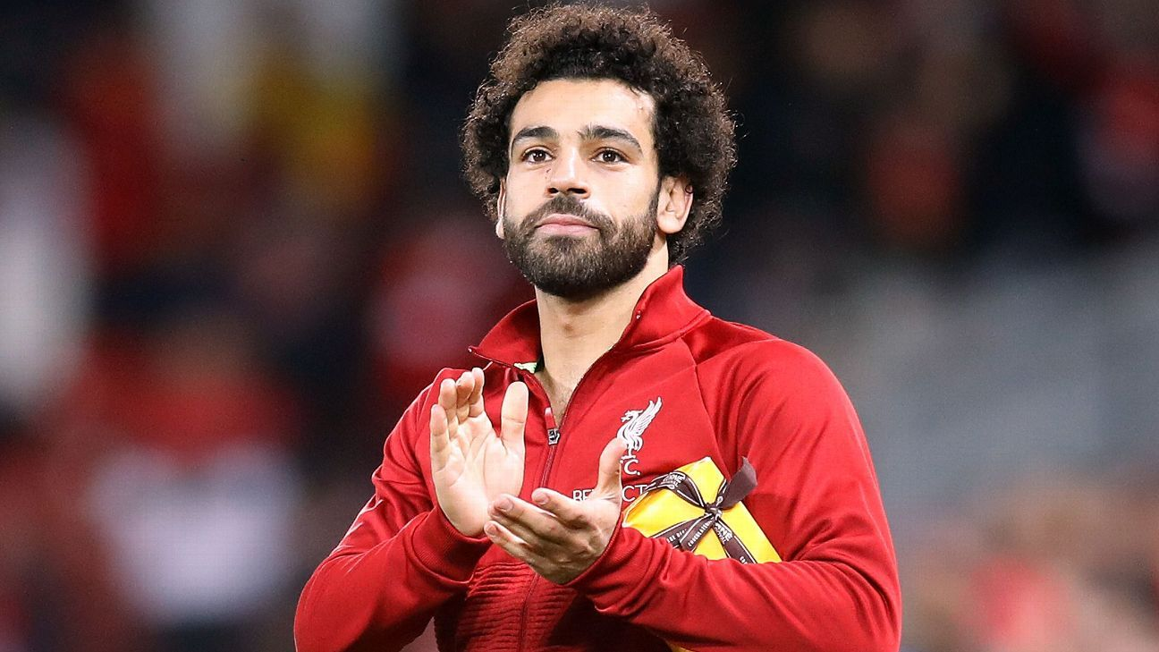 Mohamed Salah received a present from a fan at Anfield after Liverpool's win over Red Star Belgrade