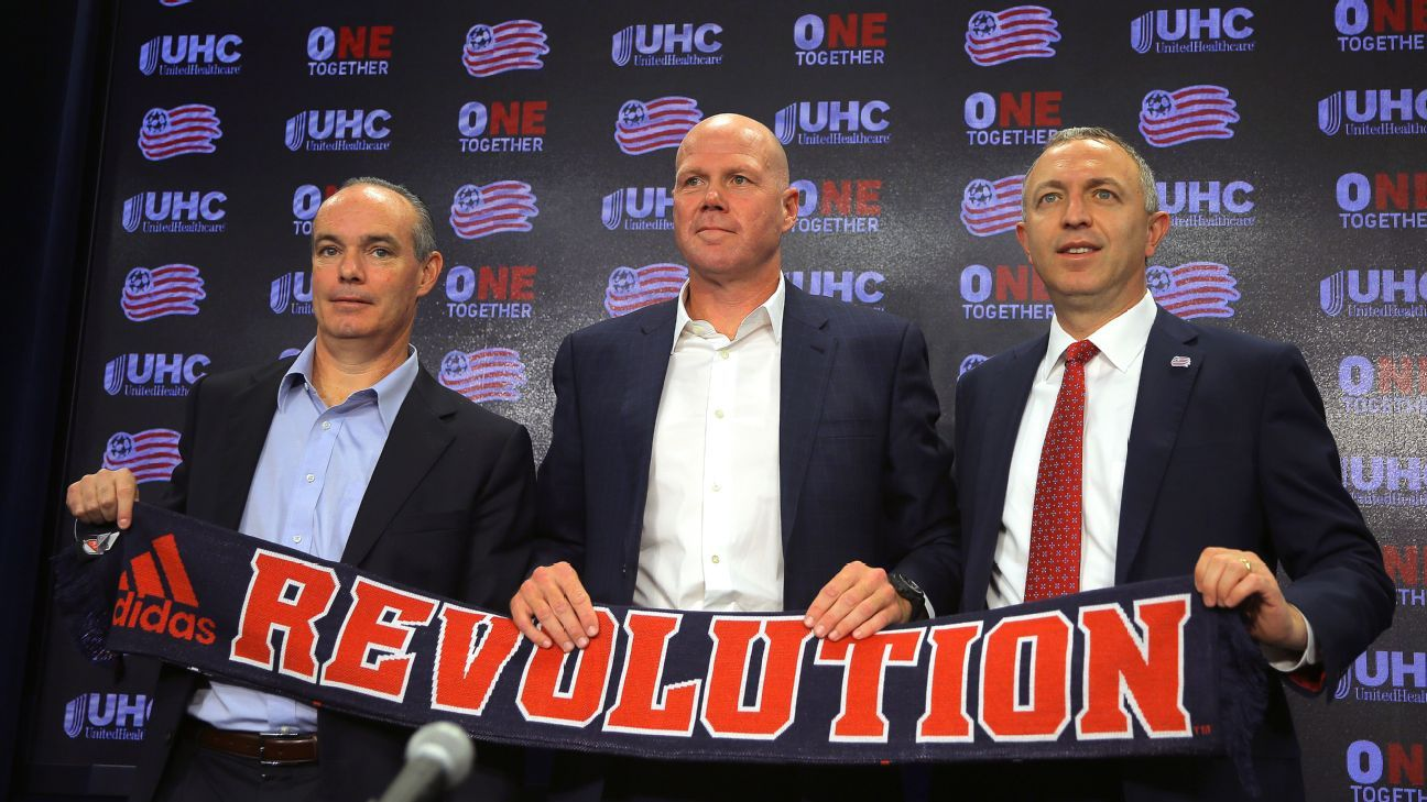 New England Revolution general manager Mike Burns, left, stands with new manager Brad Friedel, center, at the latter's introduction.