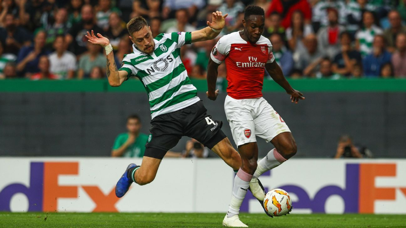 Danny Welbeck fights off a challenge from Sebastian Coates during Arsenal's Europa League match at Sporting.