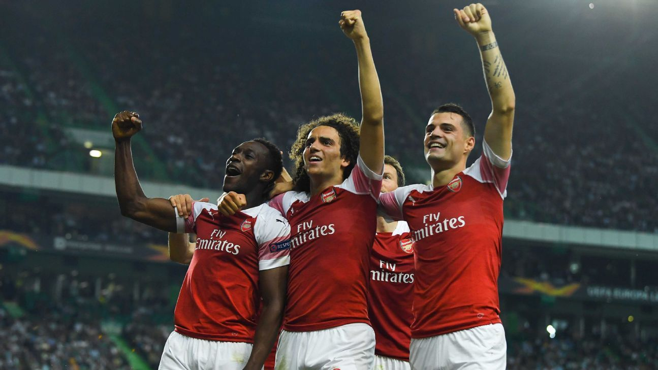 Danny Welbeck, Matteo Guendouzi and Granit Xhaka celebrate during Arsenal's Europa League win over Sporting.