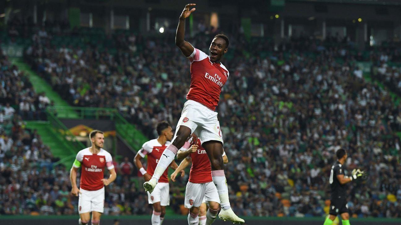Danny Welbeck celebrates after scoring the winner in Arsenal's Europa League win over Sporting.