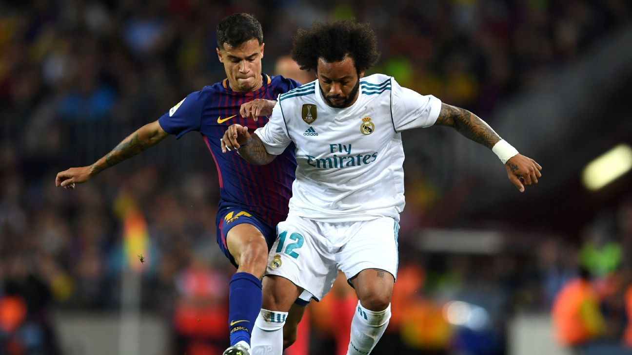 Philippe Coutinho and Marcelo vie for the ball during the La Liga match between Barcelona and Real Madrid.