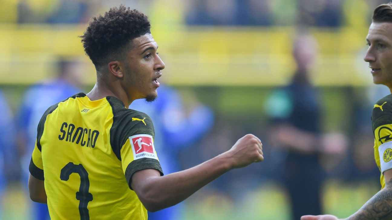 Jadon Sancho celebrates after scoring for Borussia Dortmund against Hertha Berlin.
