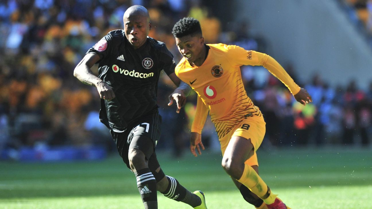 Orlando Pirates' Ben Motshwari goes past Kaizer Chiefs' Dumisani Zuma in the Soweto Derby at FNB Stadium.