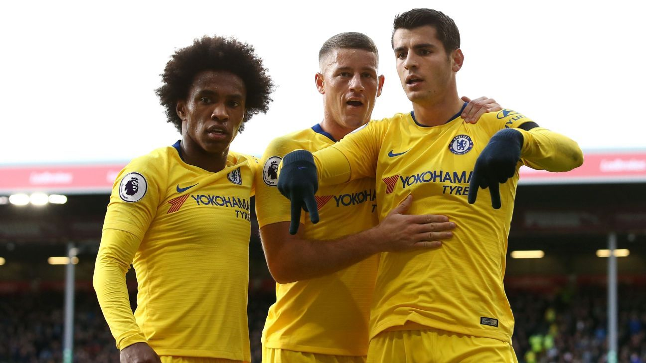 Alvaro Morata celebrates with Ross Barkley and Willian after scoring to put Chelsea ahead against Burnley.