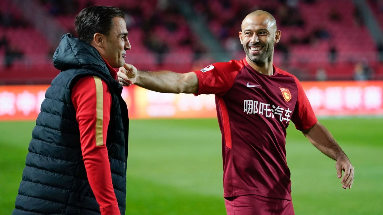 Guangzhou Evergrande coach Fabio Cannavaro and defender Javier Mascherano.
