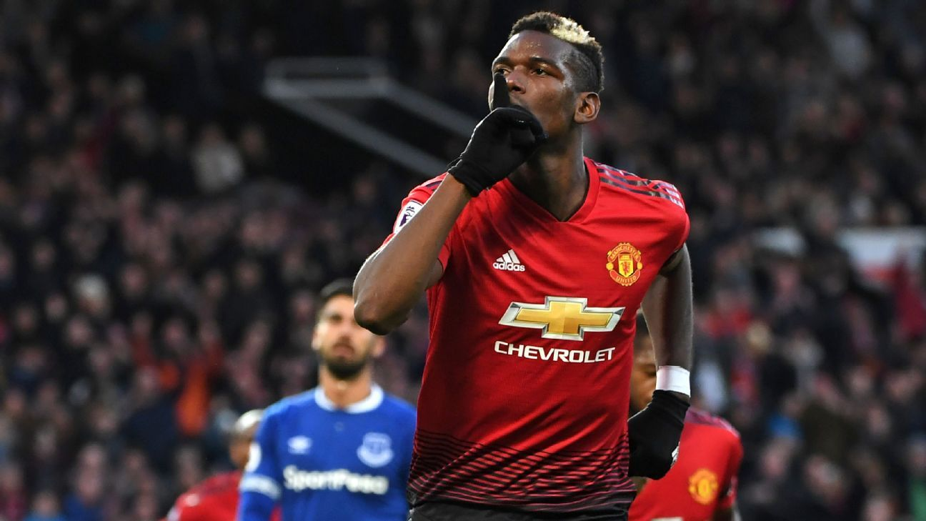 Paul Pogba celebrates after opening the scoring in Manchester United's Premier League game against Everton.