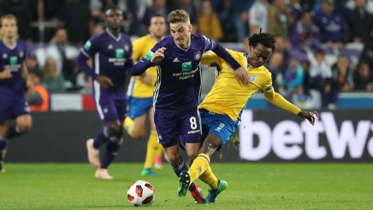 Percy Tau tackles Pieter Gerkens during Union's 3-0 upset of Anderlecht