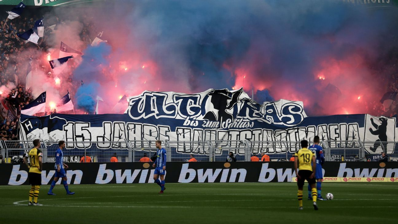Hertha Berlin fans set off pyrotechnics during the Bundesliga game against Borussia Dortmund.