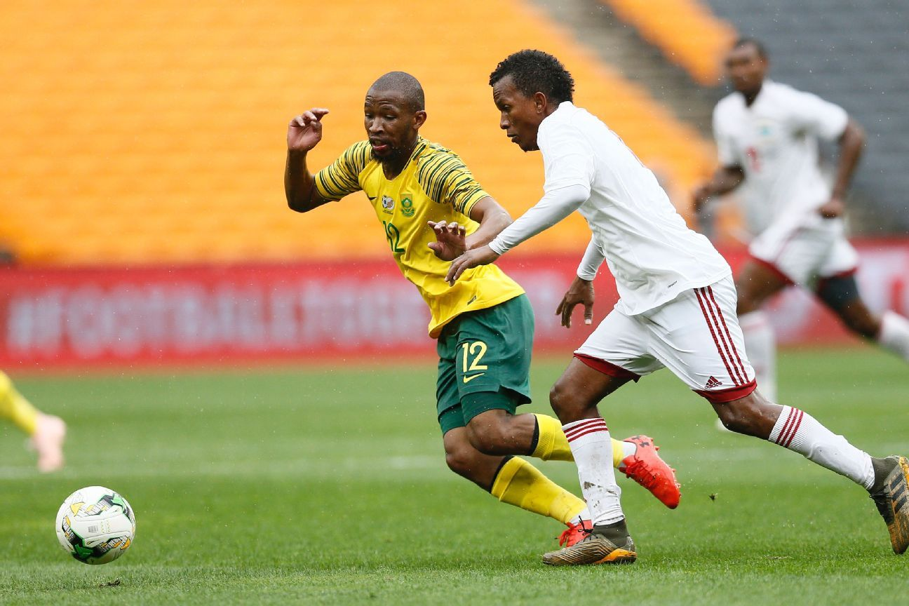 South Africa's Kamohelo Mokotjo (L) vies for the ball with Seychelles' Colin Esther (R) during the Africa Cup of Nations qualifier in Johannesburg