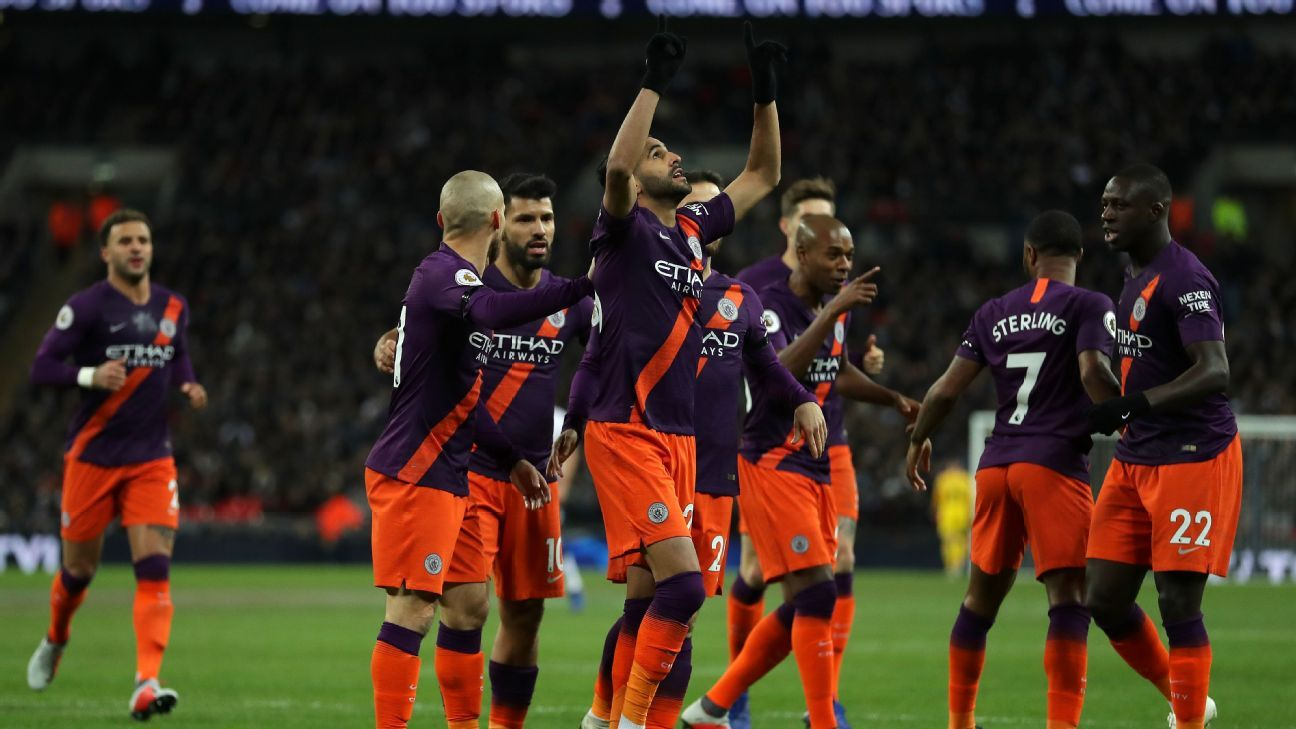 Riyad Mahrez, centre, celebrates after scoring in Manchester City's Premier League match at Tottenham.