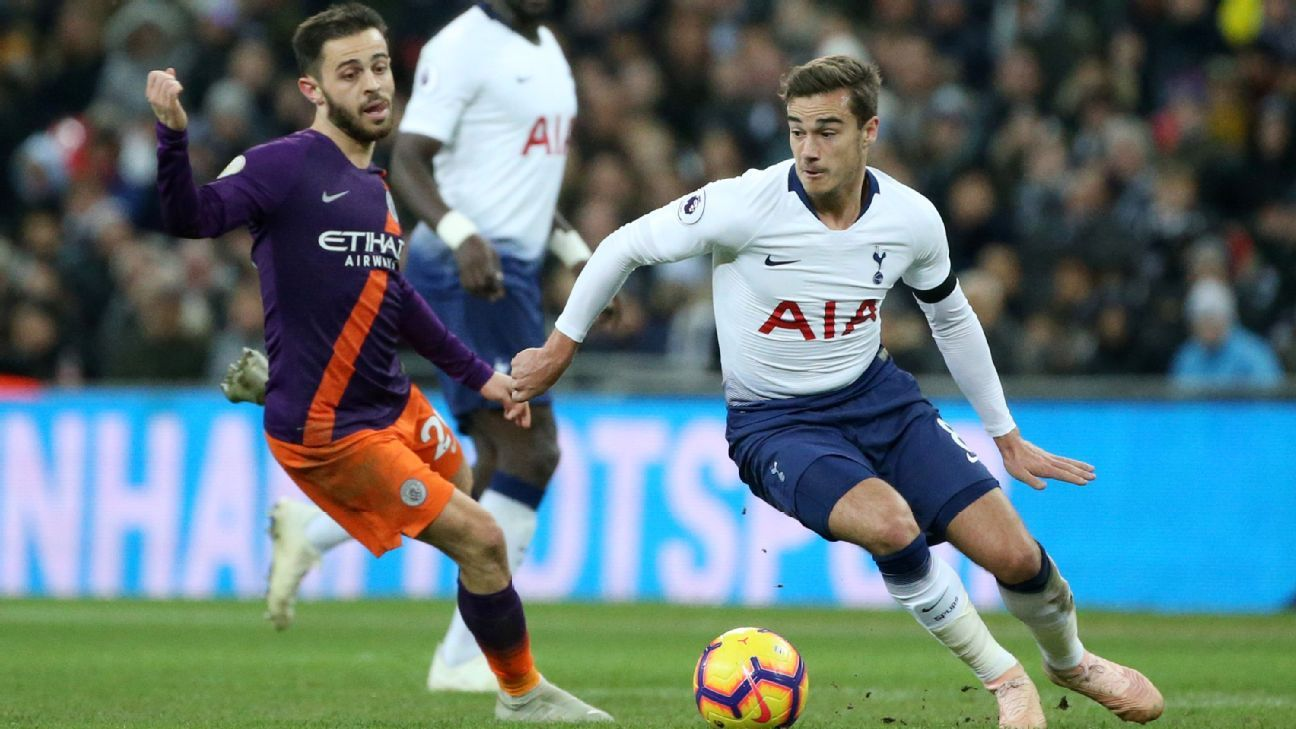 Tottenham's Harry Winks breaks away from Manchester City's Bernardo Silva.