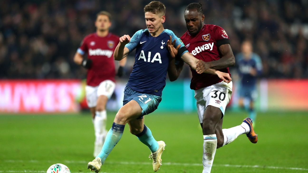 Juan Foyth of Tottenham Hotspur is challenged by Michail Antonio of West Ham.