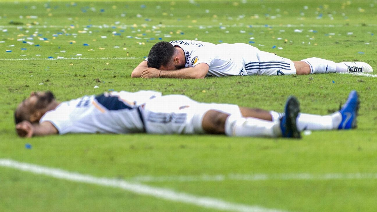 Romain Alessandrini, top, and Ashley Cole react after the LA Galaxy's MLS loss to the Houston Dynamo.