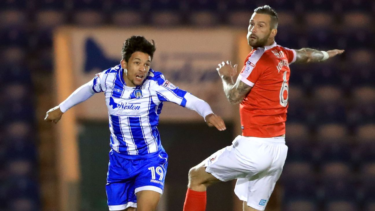 Colchester United's Macauley Bonne and Charlton Athletic's Roger Johnson
