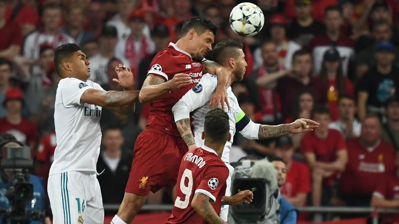 Dejan Lovren and Sergio Ramos compete for a header during the Champions League final.