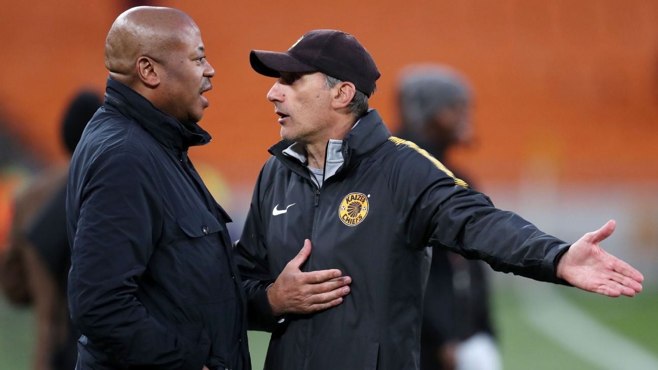 Kaizer Chiefs football manager Bobby Motaung chats with coach Giovanni Solinas