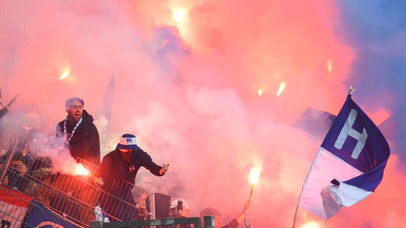 Hertha Berlin supporters burn flares during their Bundesliga football match against Borussia Dortmund.
