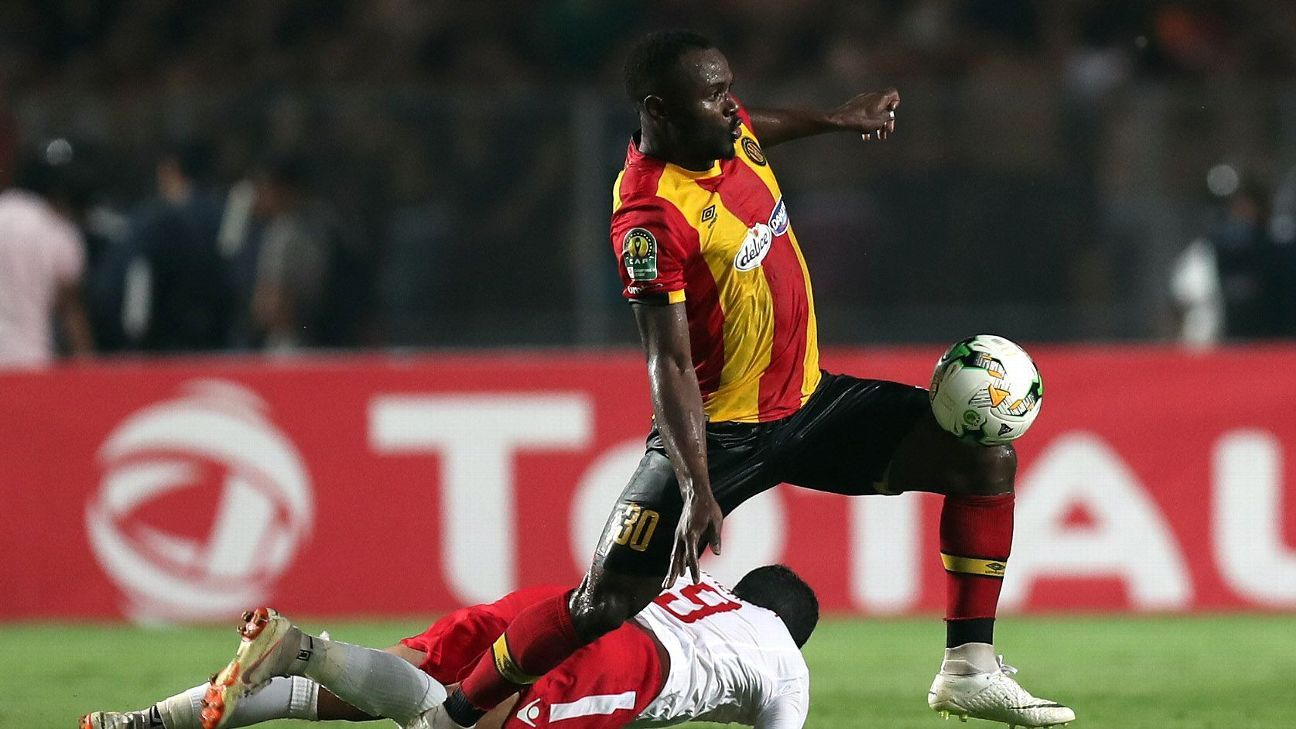 Esperance Sportive de Tunis player Franck Kom and Etoile Sportive du Sahel player Amine Chermiti battle for the ball
