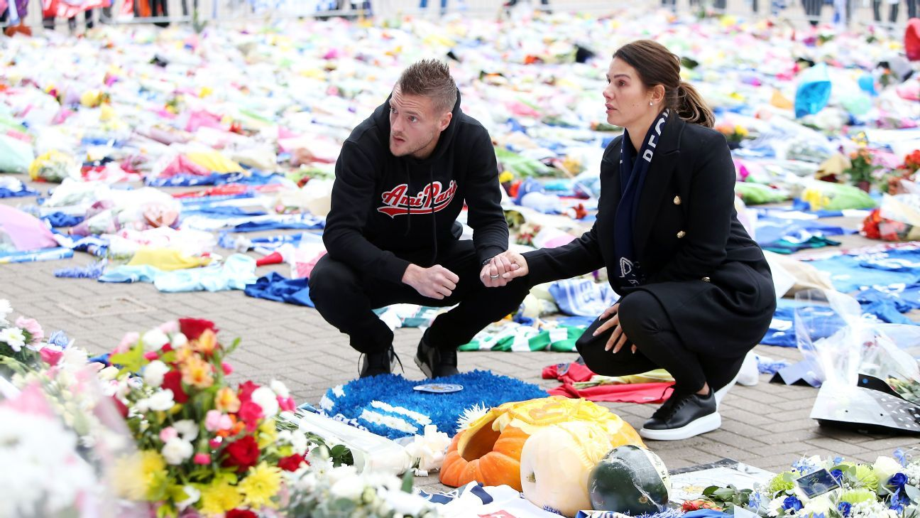 Jamie Vardy and wife Rebekah Vardy lay a wreath in memory of those killed in the helicopter crash outside King Power Stadium.