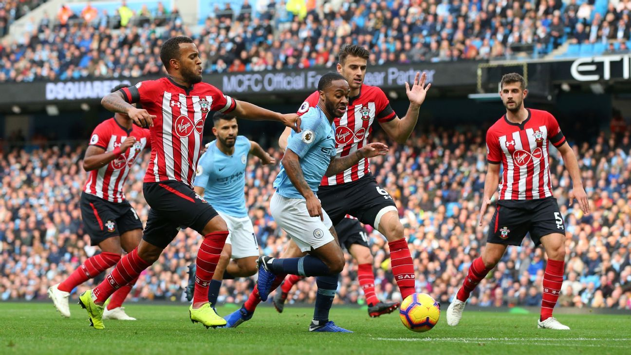 Manchester City's Raheem Sterling surges past two Southampton defenders