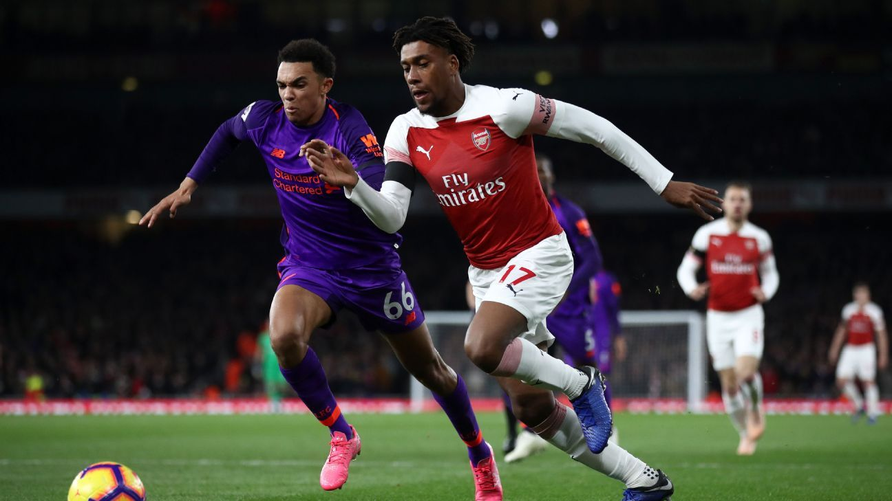 Arsenal's Alex Iwobi battles Trent Alexander-Arnold of Liverpool