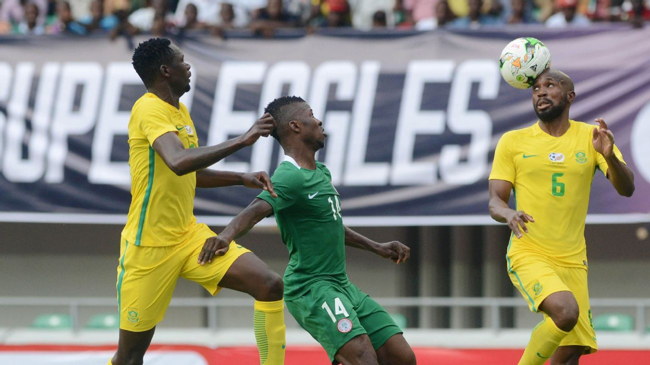 Kelechi Iheanacho of Nigeria takes on Ramahlwe Mphahlele (right) and Erick Mathoho (left) of South Africa