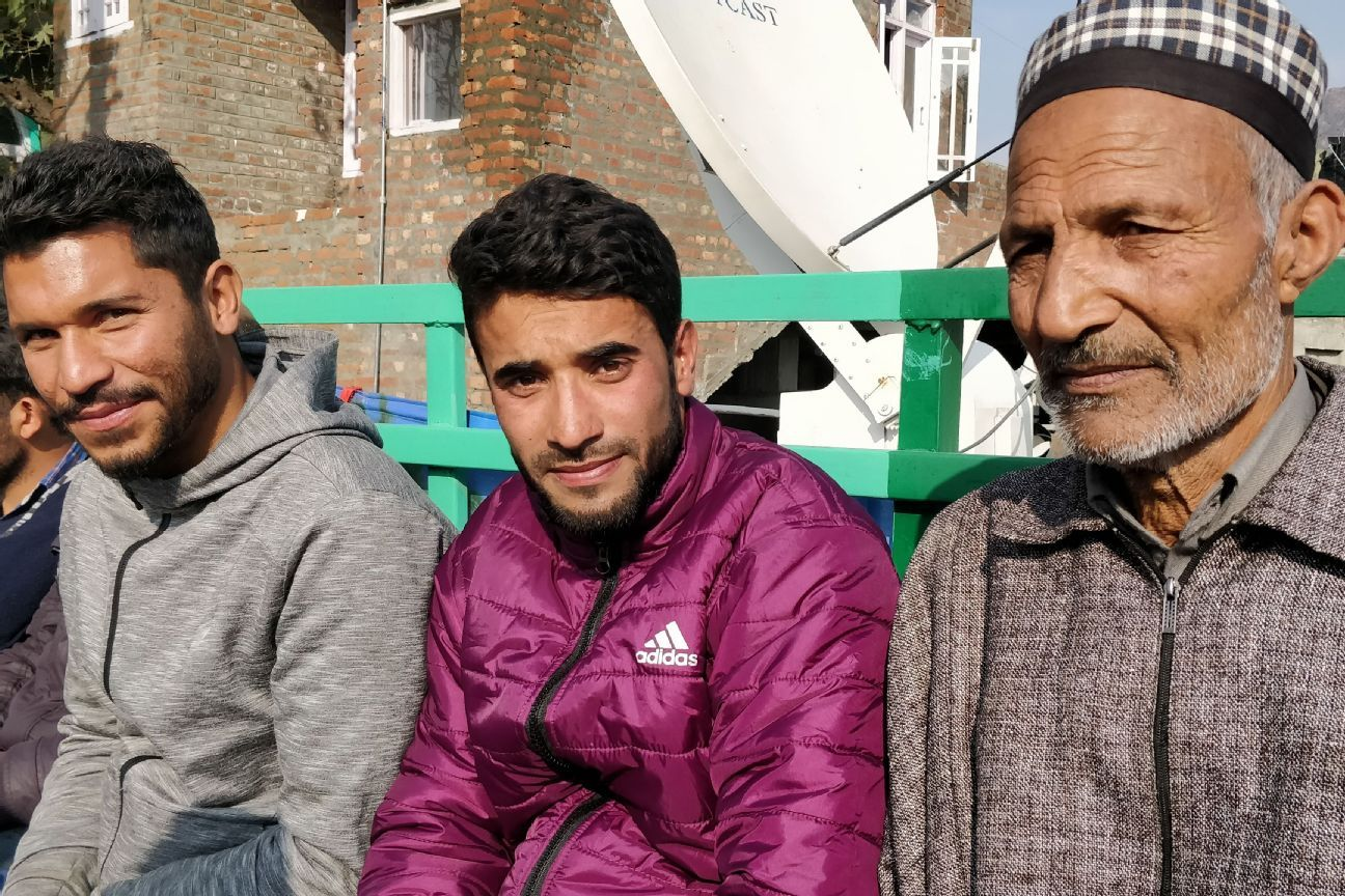 Zahid Yakub (left), who had played for the first Kashmiri team that made it to the I-League second division, watched the game from the stands.