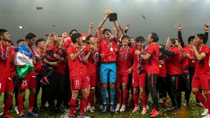 Players of Shanghai SIPG celebrate with their trophy