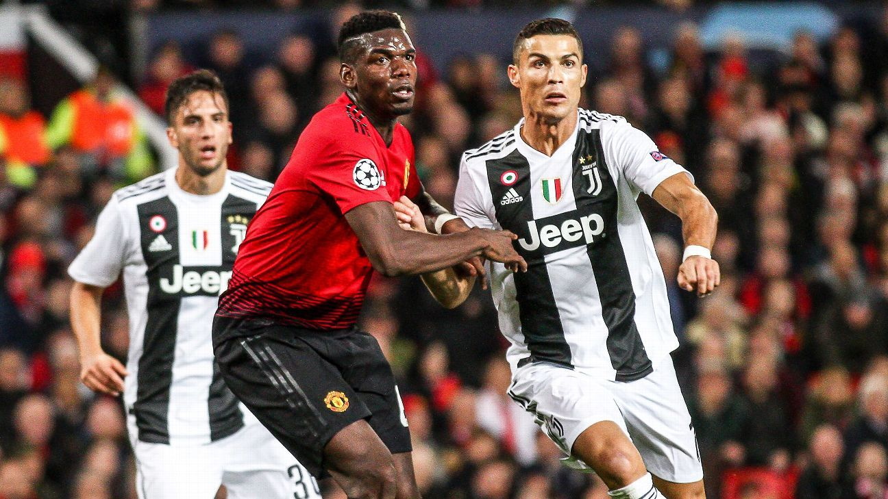 Juventus forward Cristiano Ronaldo (7) fights for the ball against Manchester United midfielder Paul Pogba (6) during the Uefa Champions League Group Stage football match n.3 MANCHESTER UNITED - JUVENTUS on 23/10/2018 at the Old Trafford in Manchester, En