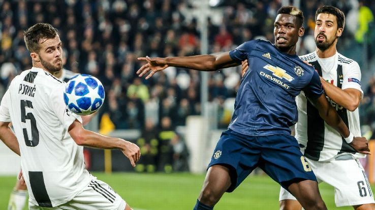 TURIN, ITALY - NOVEMBER 07: Miralem Pjanic of Juventus, Sami Khedira of Juventus and Paul Pogba of Manchester United battle for the ball during the Group H match of the UEFA Champions League between Juventus and Manchester United at  on November 7, 2018 i