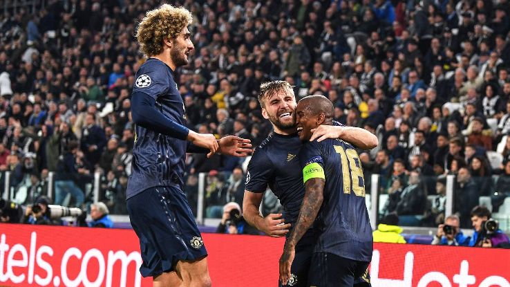 TURIN, ITALY - NOVEMBER 07: Ashley Young of Manchester United celebrates his sides second goal which came through a Alex Sandro of Juventus (not pictured) own goal with Luke Shaw of Manchester United and Marouane Fellaini of Manchester United during the U