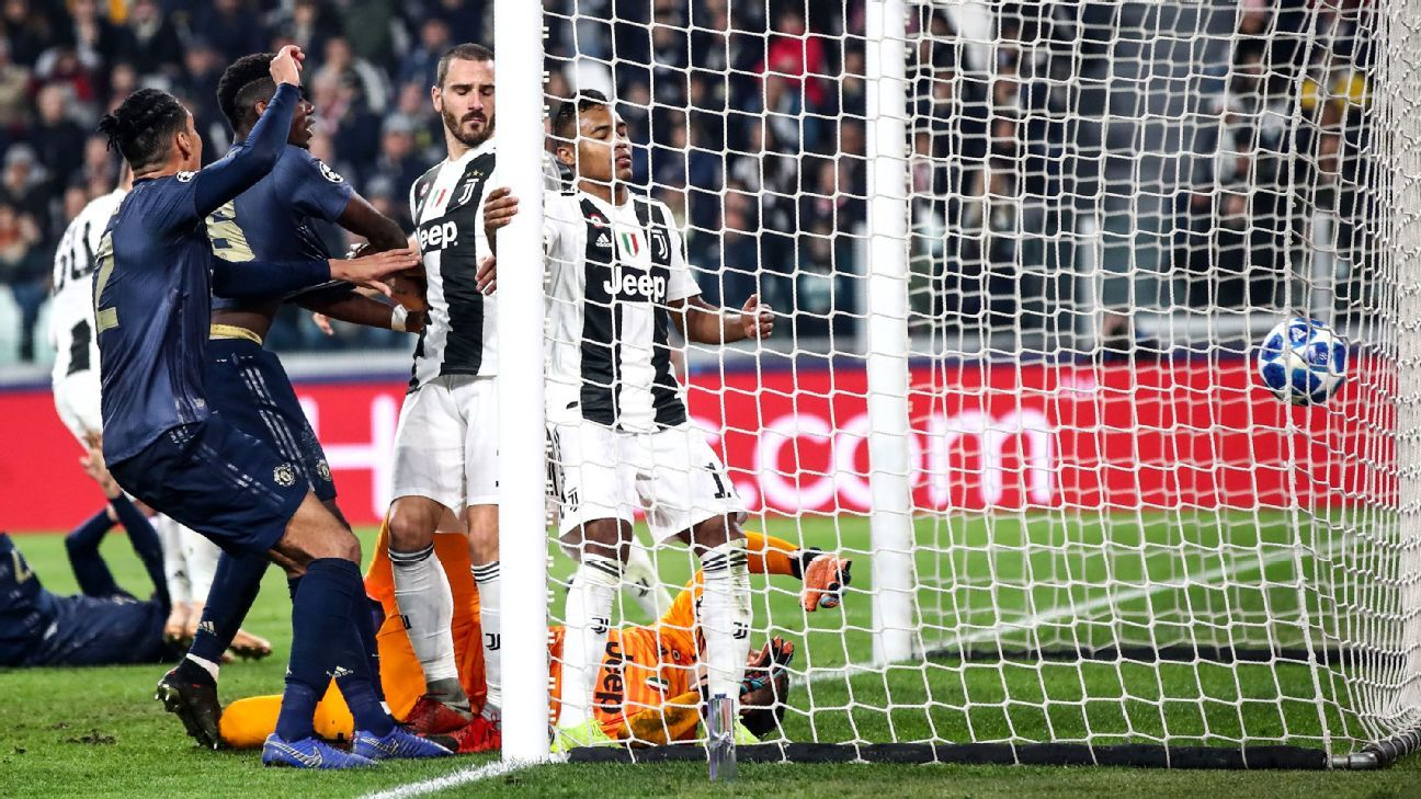 Manchester United's English defender Chris Smalling (L) and Manchester United's French midfielder Paul Pogba (2ndL) celebrate after Juventus' Brazilian defender Alex Sandro (C) scored an own goal during the UEFA Champions League group H football match Juv