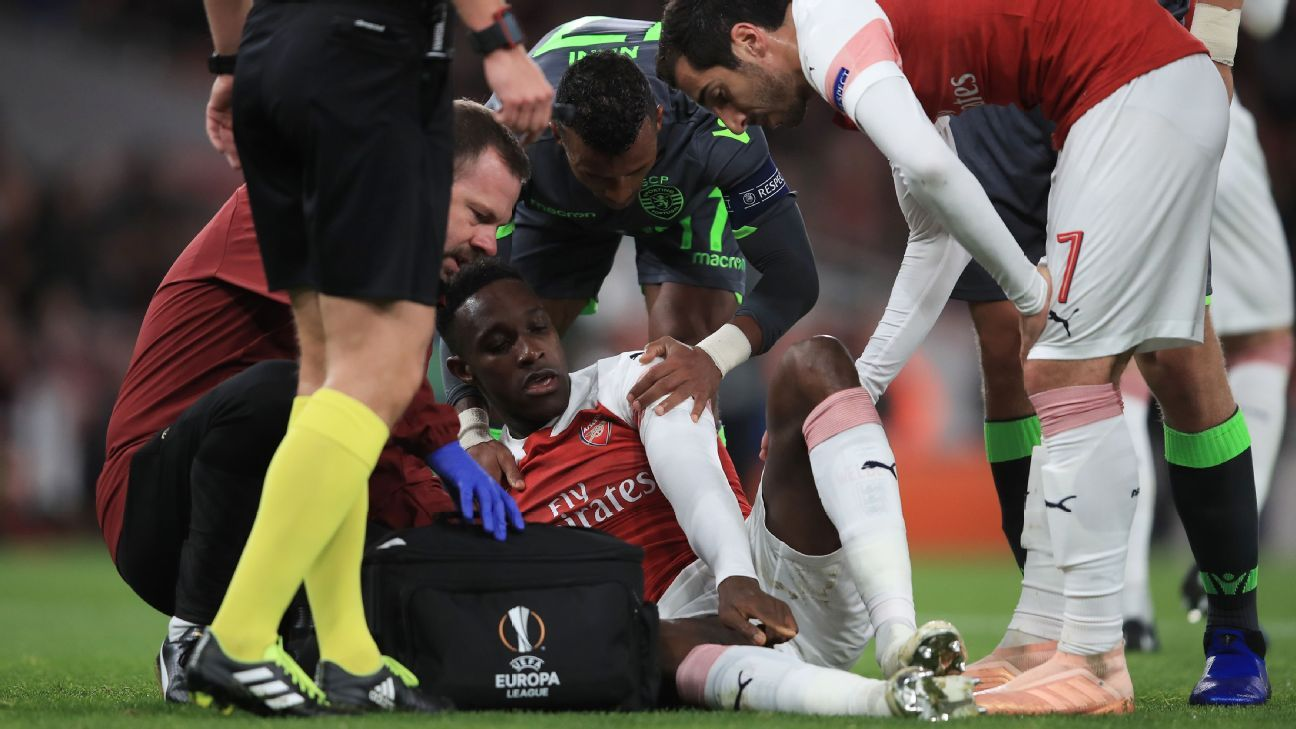 Danny Welbeck is injured in Arsenal's Europa League match against Sporting.