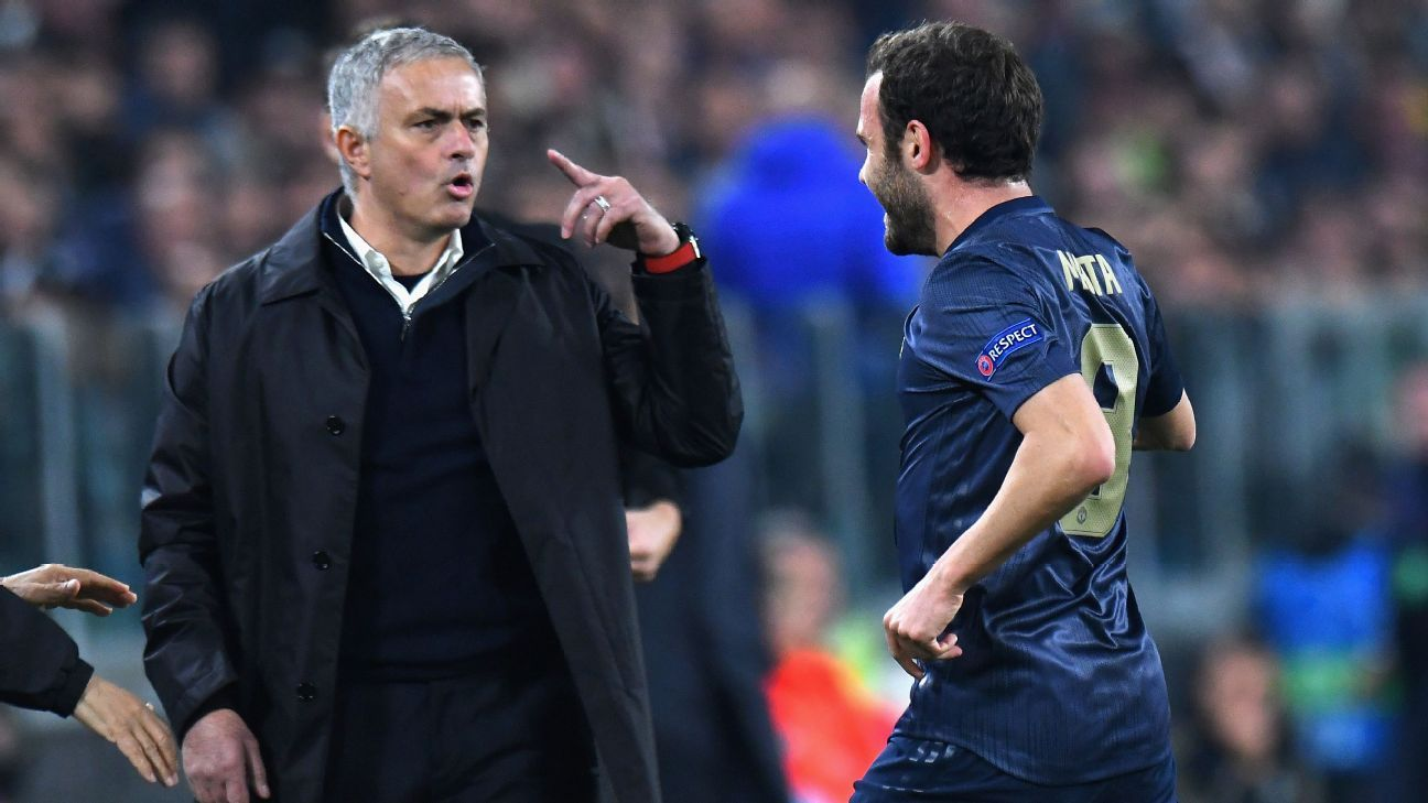 Juan Mata of Manchester United FC celebrates with his head coach Jose Mourinho