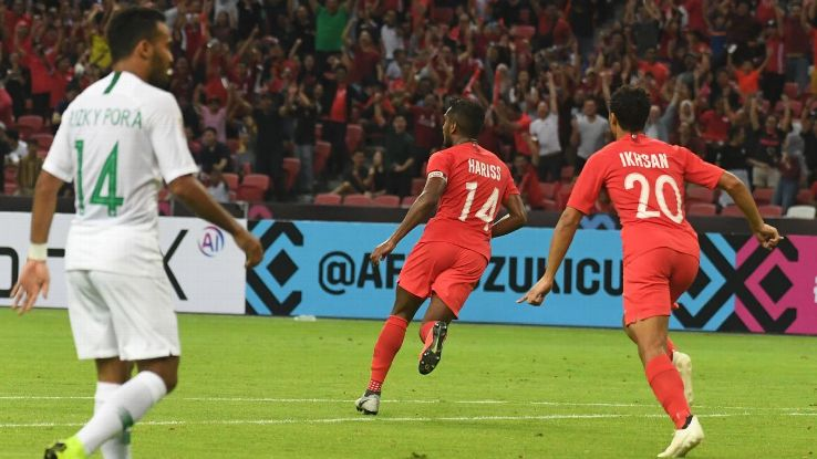 Harris Harun (C) reacts after scoring a goal against Indonesia.